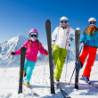 Skiing, winter fun - happy skiers on ski holiday — Stock Photo #47439335