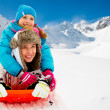 Winter fun, snow, family sledding at winter time — Stock Photo #47439947