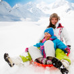 Winter fun, snow, family sledding at winter time — Stock Photo #47439949