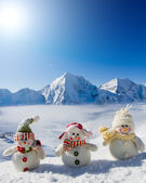 Winter, snow, sun and fun - happy snowman friends — Stock Photo