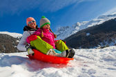 Winter fun, snow, family sledding at winter time — Stockfoto