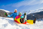 Winter fun, snow, family sledding at winter time — Stock Photo