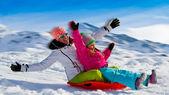 Winter fun, snow, family sledding at winter time — Stock Photo