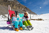 Ski, snow, sun and winter holidays - skiers in Dolomites — Stock Photo