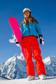 Winter holidays, winter fun- portrait of young snowboarder girl — Stock Photo