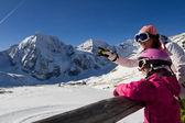 Winter,ski, snow and sun - family enjoying winter vacation — Stock Photo