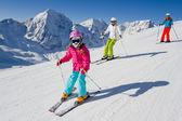 Skiing, winter, ski lesson - skiers on ski run — Stock Photo