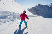 Skiing, winter, kid - skier on mountainside — Stock Photo