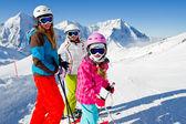 Skiing, winter fun - happy skiers on ski holiday — Stock Photo