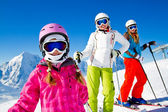 Skiing, winter fun - happy skiers on ski holiday — Stock Photo