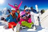 Ski, snow and winter fun - happy family ski team — Stock Photo