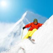 Skiing, Skier, Freeride in fresh powder snow — Stock Photo