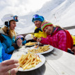 Winter, ski - skiers enjoying lunch in winter mountains — Stock Photo #47442317