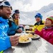 Winter, ski - skiers enjoying lunch in winter mountains — Stock Photo #47442327