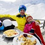 Winter, ski - skiers enjoying lunch in winter mountains — Stock Photo #47442331