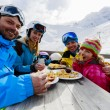 Winter, ski - skiers enjoying lunch in winter mountains — Stock Photo #47442335