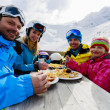 Winter, ski - skiers enjoying lunch in winter mountains — Stock Photo #47442337