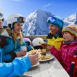 Winter, ski - skiers enjoying lunch in winter mountains — Stock Photo