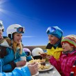 Winter, ski - skiers enjoying lunch in winter mountains — Stock Photo #47443037
