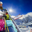 Ski lift, skiing, ski resort - happy skiers on ski lift — Stock Photo