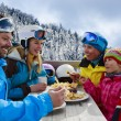 Winter, ski - skiers enjoying lunch in winter mountains — Stock Photo #47443301