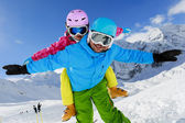 Ski, winter, snow, skiers, sun and fun - family enjoying winter — Stock Photo