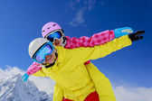 Ski, skier, snow and fun  - family enjoying winter vacations — Stockfoto