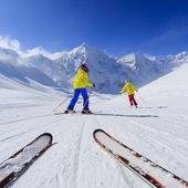 Skiing, skiers on ski run - child skiing downhill, ski lesson — Stock Photo
