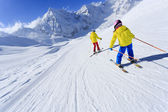 Skiing, skiers on ski run - child skiing downhill, ski lesson — Stock Photo