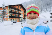 Winter holidays - child in winter resort — Stock Photo