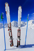 Skiing, winter season , mountains and ski equipments on ski run — Stock Photo