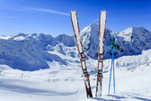 Skiing, winter season , mountains and ski equipments on ski run — Stock Photo