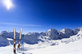 Skiing, winter season , mountains and ski equipments on ski run — Stock fotografie
