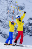 Ski, skier, sun and winter fun - skiers enjoying winter holidays — Stock Photo