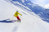 Skiing, skier, winter sport - woman skiing downhill — Stock Photo