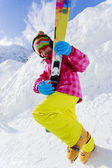 Ski, winter fun - lovely skier girl enjoying ski holiday — Stock Photo