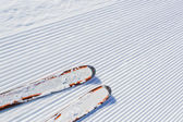 Skiing background - fresh snow on ski slope — Stock Photo