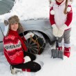 Winter, travel - woman putting snow chains onto tyre of car — Stock Photo #47812723