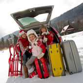 Winter, travel - family with baggage ready for the travel for winter vacation — Stock Photo