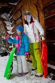 Winter, snow, sledding - family fun at winter time — Stock Photo