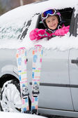 Winter, ski - happy child on the road for ski holidays — Stock Photo