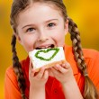 Spring sandwich - lovely girl eating cottage cheese with chives on bread — Stock Photo