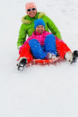 Winter playing, fun, snow and family sledding at winter time — Stock Photo