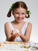 Happy Easter - lovely girl making easter cookies — Stok fotoğraf