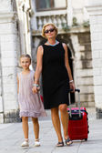 Touring Venice - lovely girl and mother with the suitcase in Venice — Stock Photo