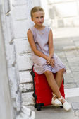 Touring Venice - lovely girl with the suitcase in hotel — Stock Photo