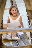 Girl with netbook - young girl with netbook resting on the beach — Stock Photo