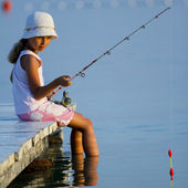 Fishing - lovely girl fishing on the pier — Stock Photo