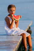 Summer joy, lovely girl eating fresh watermelon on the beach — Stock Photo