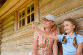 Mountain hike - young girl with mother in mountain hut — Stock Photo